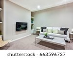 room has a tv on the wall near... | Shutterstock . vector #663596737