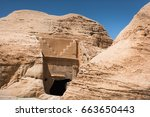 Small photo of A nabatean tomb entrance as seen in Petra, Jordan. Note the characteristic stair-like ornamentation of the facade.