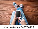 young woman using smart phone | Shutterstock . vector #663704497