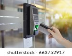 young woman hold keycard to... | Shutterstock . vector #663752917