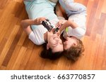 mother and her little son... | Shutterstock . vector #663770857