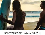 couple of surfers standing on... | Shutterstock . vector #663778753