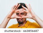 man making a hand heart frame | Shutterstock . vector #663856687