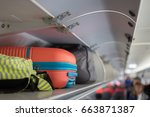 carry on luggage on the top... | Shutterstock . vector #663871387