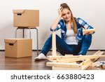 worried woman moving into new... | Shutterstock . vector #663880423