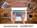 hands typing laptop of top view ... | Shutterstock . vector #663884287