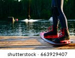 men   s feet on a wakeboard on... | Shutterstock . vector #663929407