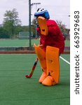 Small photo of Field hockey goalie in practice saving a shot