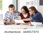 three entrepreneurs analyzing... | Shutterstock . vector #664017373