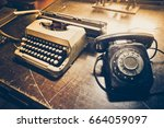 old telephone and typewriter  | Shutterstock . vector #664059097
