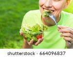 woman having lunch break... | Shutterstock . vector #664096837