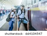 multiethnic travelers are... | Shutterstock . vector #664104547