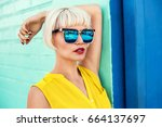 beautiful young woman walking... | Shutterstock . vector #664137697