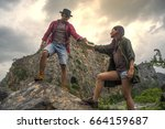 male and female hikers climbing ... | Shutterstock . vector #664159687