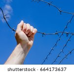 hand is tearing wire against... | Shutterstock . vector #664173637