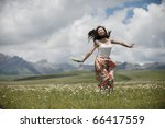 a girl jump under the sunlight. | Shutterstock . vector #66417559