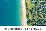 aerial view on small suburb on... | Shutterstock . vector #664178323