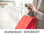 asian woman holding shopping