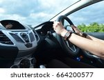 woman's hands on a steering... | Shutterstock . vector #664200577