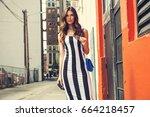 beautiful brunette young woman... | Shutterstock . vector #664218457
