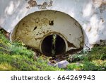 A Large Pipe Under An Old...