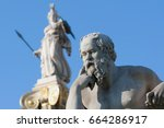 Small photo of classical statue of Socrates from side with athena statue above and back