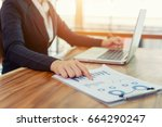 business woman hand pointing to ... | Shutterstock . vector #664290247