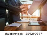 business team to cooperate in... | Shutterstock . vector #664290397