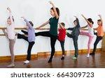happy  positive ballet dancers... | Shutterstock . vector #664309723