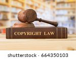 Small photo of Copyright law books and a judge gavel on desk in the library. concept of legal education.