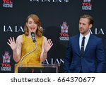 Small photo of LOS ANGELES, CA - DECEMBER 7, 2016: Actors Emma Stone & Ryan Gosling at the TCL Chinese Theatre, Hollywood, where the stars of La La Land had their hand & footprints set in cement.