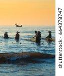 Fisherman Work On Beach In...