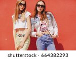 beautiful models pose for a... | Shutterstock . vector #664382293