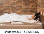 bathing woman relaxing in bath...   Shutterstock . vector #664387537