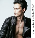 young handsome man  leather... | Shutterstock . vector #664402543