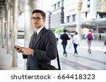 asian officer using tablet | Shutterstock . vector #664418323