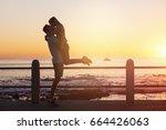 young woman jumps on boyfriend... | Shutterstock . vector #664426063