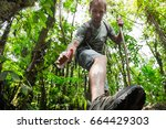 hiker applying repellent on his ... | Shutterstock . vector #664429303