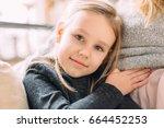 daughter holding mom's belly.... | Shutterstock . vector #664452253