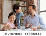young bearded father and his... | Shutterstock . vector #664480663