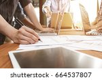 business team meeting to... | Shutterstock . vector #664537807