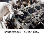 camshaft close up  four valve... | Shutterstock . vector #664541857