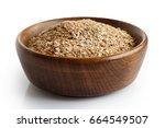 Wheat Bran In Dark Wooden Bowl...