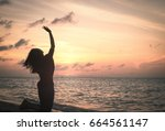 praying and surrender concept ... | Shutterstock . vector #664561147