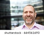portrait of laughing... | Shutterstock . vector #664561693