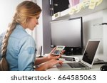 woman at home office using... | Shutterstock . vector #664585063