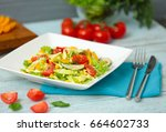 plate with tasty salad on table | Shutterstock . vector #664602733