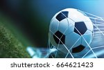 soccer ball in goal on green... | Shutterstock . vector #664621423