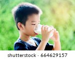 young asian thai boy drinking... | Shutterstock . vector #664629157