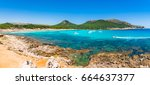 Small photo of Panorama view of the picturesque bay with boats, beach Cala Agulla in Cala Ratjada, Majorca Spain.